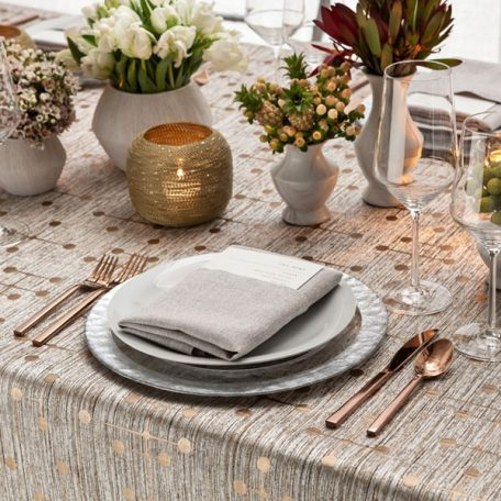 Bronze Jacks Table Linen featuring a Silver Alkaline Dinner Napkin on top of our Clear frost with Silver Rim Glass Charger