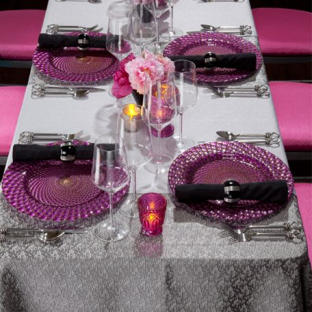 Charcoal Charmed Table Linen with our Luxe Fuchsia Glass Charger and Black Shantung Napkin