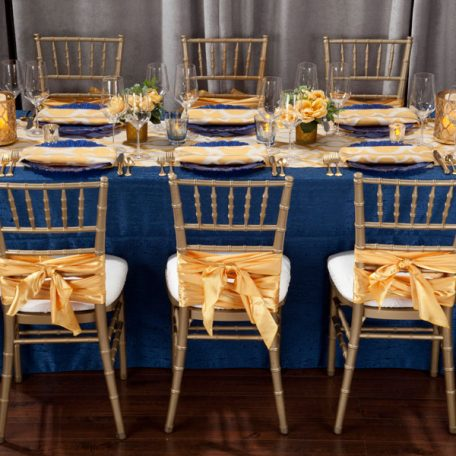 Daffodil Miramar Table Runner and Napkins show over Lapis Contour Table Linen
