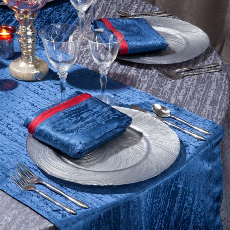 Gunmetal Contour Table Linen with Lapis Contour Table Runners and Napkins on top of our Silver Tidal Wave Charger.