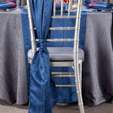 Gunmetal Contour Table Linen with Lapis Contour Chair Ties.