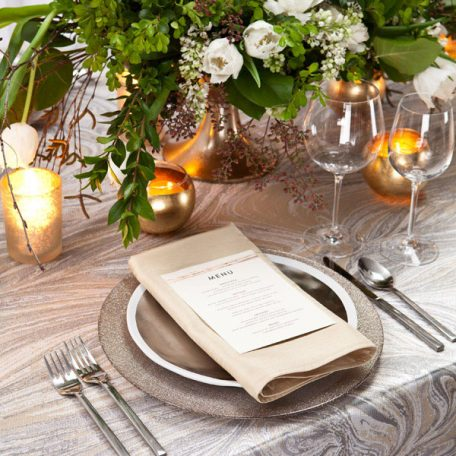 Magma Table Linen with a Lino Ginger Glitter Charger and Stone Shantung Napkin