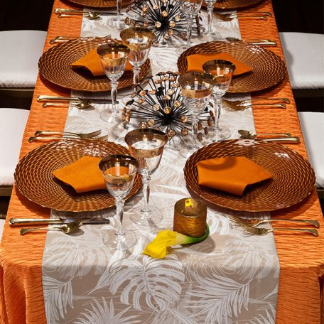 Mandarin Rhythm Table Linen with White Calypso Table Runner