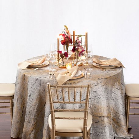 Pyrite Marble Table Linen with our Ice with Gold Rimmed Charger topped off with a Gold Lamour Napkin