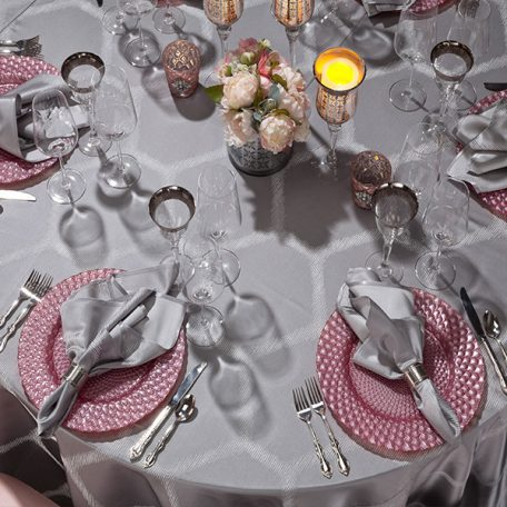 Silver Apiary Table Linen with Pink Luxe Glass Charger and Silver Apiary Dinner Napkin