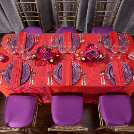 Poppy Duet Tablescape Featuring our Poppy Bravado Table Runner and our Luxe Fuchsia Glass Charger