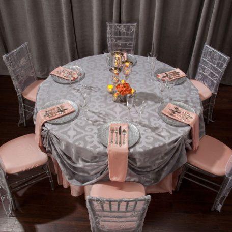 Silver Bravado Table Linen shown over Apricot Shantung.