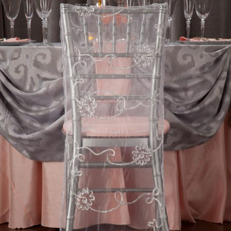 Silver Bravado Table Linen Shown over Apricot Shantung. Silver Chiavari Chair with our White Shalimar Chair Jacket.