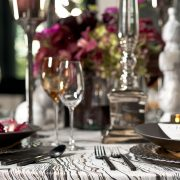 An elegant pattern of black, gold and taupe, this signature Azari table linen features a luster side and a matte side. Rent it here today at Fabulous Events