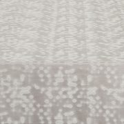 Innovative digital patterns that change with light give the Silver Lexi table runner's lustrous silvery white fabric its intrigue. Rent it here from Fabulous Events