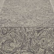 A quintessential old world classic with a twist, the small scale paisley of this Prado table runner is a versatile neutral with shimmering metallic shades.