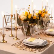 With its supremely simple shape and controlled, but edgy pattern, the Gold Deco Metal Placemat will highlight fine china, gold-rimmed crystal and simple flatware in classic Deco-era style. Use them to enhance an over-the-top ethnic theme of stylized patterns and brilliant colors. Rent it here from Fabulous Events.