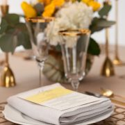 With its supremely simple shape and controlled, but edgy pattern, the Gold Deco Metal Placemat will highlight fine china, gold-rimmed crystal and simple flatware in classic Deco-era style. Use them to enhance an over-the-top ethnic theme of stylized patterns and brilliant colors. Rent it here today from Fabulous Events