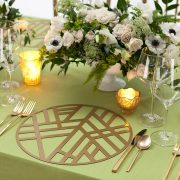 Our Gold Edge Metal Placemat is elegantly simple, with a soothing graphic pattern that has a calming Zen-like personality. The pattern is somehow reminiscent of bamboo stalks, simple enough to allow other patterns to take center stage, but bold enough to add interest to any setting. Rent it here today.