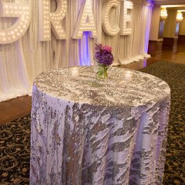 Our Silver Mermaid sequin table linen is the perfect rental for any event. Shown here on hi-top tables. Get stress free rentals from Fabulous Events.