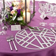 The amazing combination of geometric shapes and linear patterns of the Platinum Edge Metal Placemat is warming yet still edgy. The design roots originate from ancient traditions yet are modern in execution. Rent it here from Fabulous Events, along with plenty of other metal placemats for your event tables.