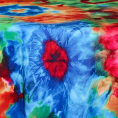 Rent our Tie Dye retro table linen for parties and events.